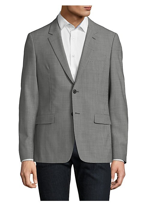Image of From the Saks IT LIST. THE JACKET. The wear everywhere layer that instantly dresses you up. Essential tailored jacket in modern houndstooth print. Notch lapels. Long sleeves. Button cuffs. Button front. Chest welt pocket. Waist flap pockets. Back vent. Ab