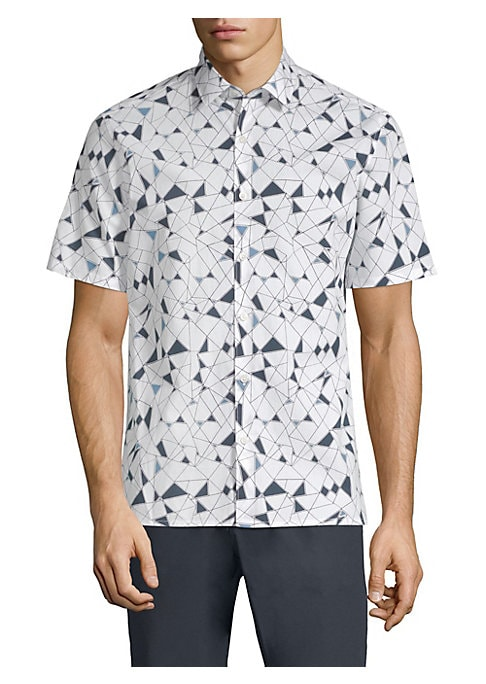"""Image of Cotton button-down shirt with allover geometric print. Point collar. Short sleeves. Button front. Back yoke. About 27"""" from shoulder to hem. Cotton. Machine wash. Imported."""