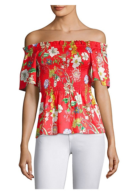 "Image of Shirred off-the-shoulder top with a bright floral print. Bandeau neckline. Short off-the-shoulder sleeves. Pullover style. Shirred bodice. About 24"" from shoulder to hem. Cotton. Dry clean. Imported. Model shown 5'10"" (177cm) is wearing a US size small."