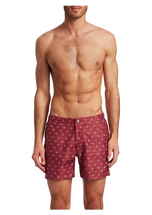 """Image of EXCLUSIVELY OURS. From the Modern Collection. Comfy swim shorts with an allover paisley print. Partially elasticized waistband. Button closure. Side slip pockets. Back flap pocket. Rise, about 9"""".Inseam, about 10"""".Polyester microfiber satin. Machine wash."""