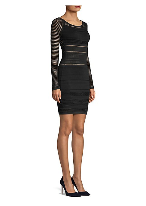 """Image of Banded mixed ribbing shapes fitted mini dress. Bateau neckline. Long sleeves. Pullover style. Partially lined. About 35"""" from shoulder to hem. Rayon. Dry clean. Imported. Model shown is 5'10"""" (177cm) and wearing US size Small."""