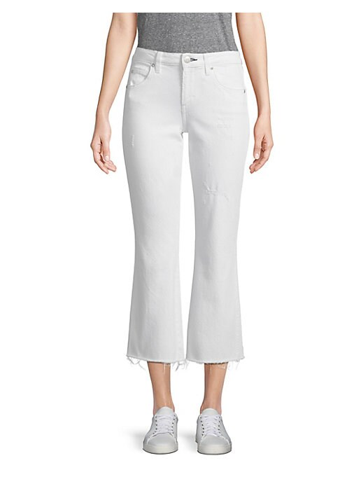 """Image of Cotton flare jeans with distressed details. Belt loops. Front zip-fly with button closure. Five-pocket style. .Rise, about 9"""".Inseam, about 26"""". Cotton/elastane. Machine wash. Made in USA. Model shown is 5'10"""" (177cm) wearing US size 4. ."""