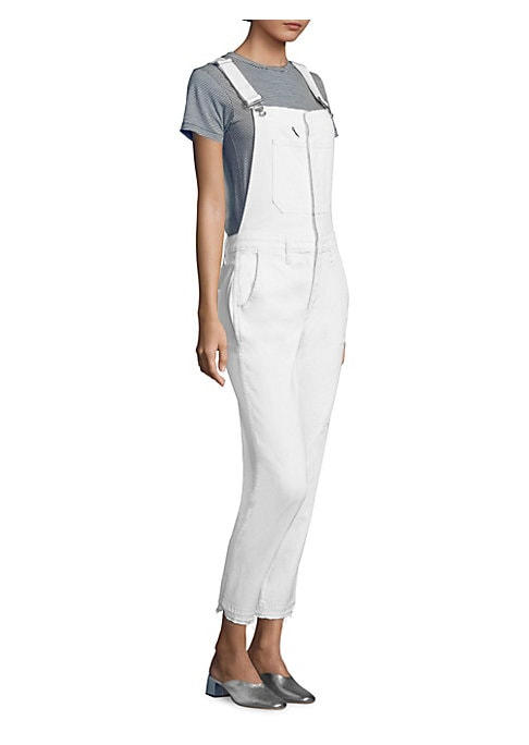"""Image of Cotton denim overalls with frayed hems. Adjustable shoulder straps. Square neck. Sleeveless. Front and back patch pocket. Front slash pockets. Belt loops. Pull-on style. Rise, about 10"""".Inseam, about 26"""".Cotton/elastane. Machine wash. Made in USA. Model s"""