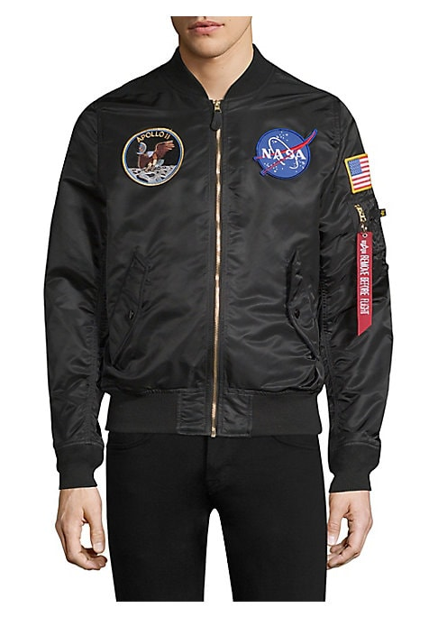 "Image of Classic bomber with embroidered NASA patches and siganture arm pocket. Baseball collar. Long sleeves. Front zip closure. Flap snap button pockets. Ribbed trim.26"" shoudler to hem. Nylon. Lined. Dry clean. Imported."