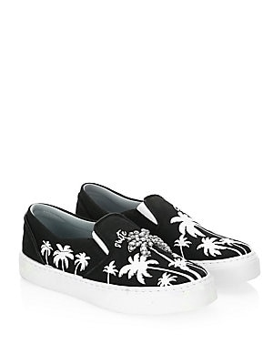 Image of Fun canvas slip-on sneakers in monochrome palm tree print Canvas upper Slip-on style Elastic goring Leather lined Rubber sole Made in Italy. Women's Shoes - Contemporary Womens Shoe. Chiara Ferragni. Color: Black White. Size: 38 (8).