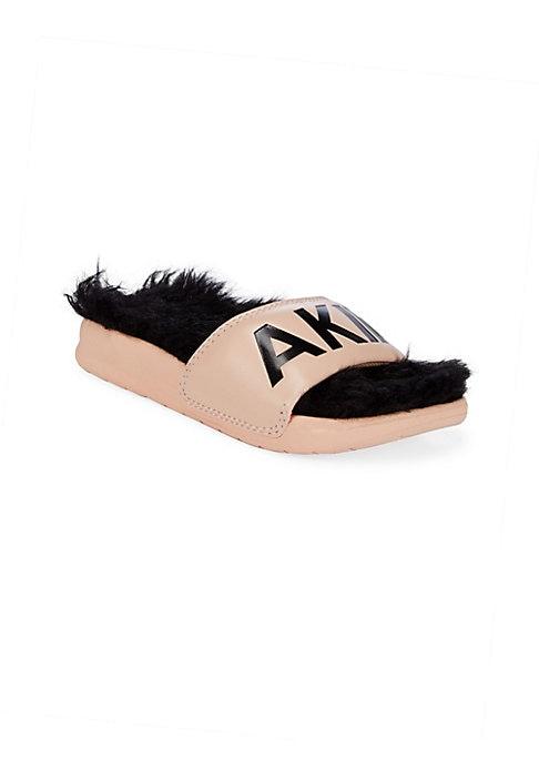 Image of Plush faux fur lines playful logo slides. EVA upper. Slip-on style. Open toe. Faux fur lining. Molded EVA sole. Imported.