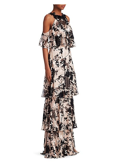 """Image of Tiered, ruffled gown finished with an embellished neckline. Roundneck. Sleeveless. Concealed back zip. Back button with keyhole cutout. About 64"""" from shoulder to hem. Nylon/viscose/silk. Lined. Dry clean. Imported. Model shown is 5'10"""" (177cm) wearing US"""