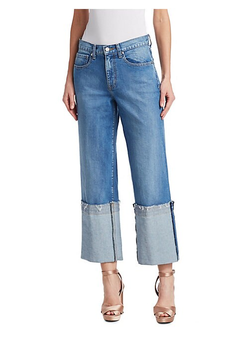 Image of These jeans' cuffed aesthetic offers a distressed vintage look. Designed in a light wash, these jeans exude timelessness. Belt loops. Five-pocket style. Zip fly with button closure. Matte finish. Cotton/lycra. Dry clean. Made in USA. SIZE & FIT. Wide-leg