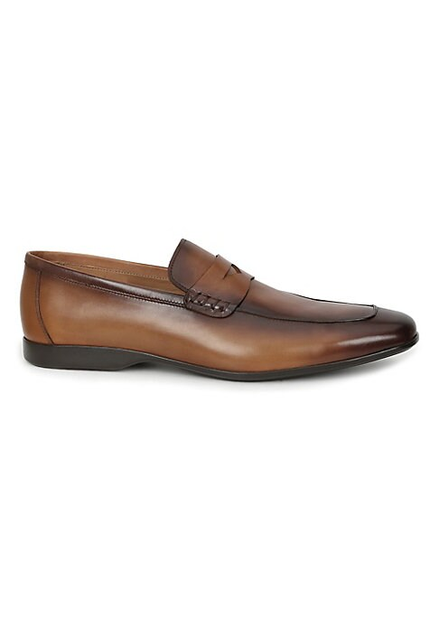 Image of Burnished calf updates sharp penny loafers. Leather upper. Slip-on style. Almond toe. Leather lining. Padded insole. Rubber sole. Made in Italy.