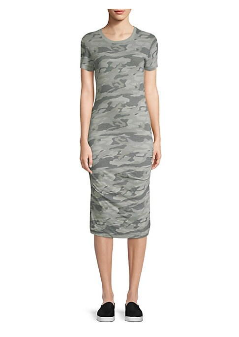 "Image of Camo T-shirt dress with a shirred side detail. Roundneck. Short sleeves. Pullover style. About 35"" from shoulder to hem. Polyester/cotton/rayon. Hand wash. Imported. Model shown is 5'10"" (177cm) wearing US size Small."