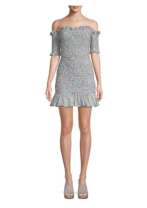 """Image of Flirty ditsy floral mini dress with puckered smocking. Ruffled off-the-shoulder neckline. Smocked short sleeves. Pullover style. Smocked bodice. Ruffled hem. About 27"""" from bust to hem. Cotton. Dry clean. Made in USA. Model shown is 5'10"""" (177cm) wearing"""