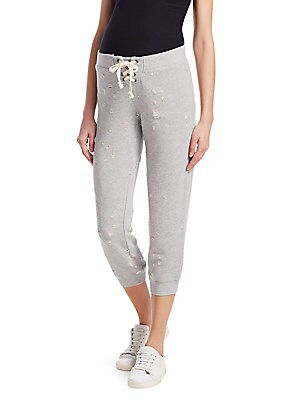 """Image of Cozy distressed jogger pants in soft cotton Elasticized waist with tie closure Pull-on style Banded cuffs Inseam, about 22"""" Rise, about 11"""" Cotton Machine wash Made in USA Model shown is 5'10 (177cm) wearing US size Small. Contemporary Sp - Casual Separat"""