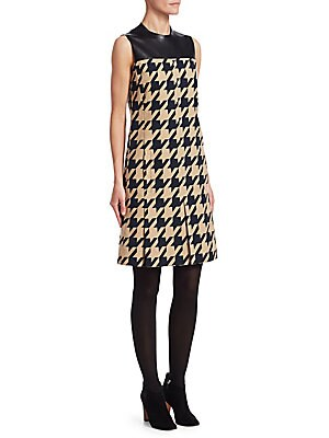 Image of A blown-up houndstooth check skips across most of this sleeveless dress, with a leather panel framing the neckline. Oversized pleats in the skirt add to the modish feel of the garment. Roundneck Sleeveless Concealed back zip closure Waist welt pockets Lin