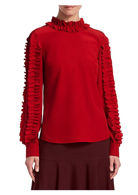 Image of A chic statement top in eye-catching red. Striking ruffle trim sleeves and neckline make this a stand-out piece for your wardrobe. Ruffle crewneck. Long sleeves with ruffle trim. Back button closure. Back box pleat. Hi-low hem. Silk. Dry clean. Imported.