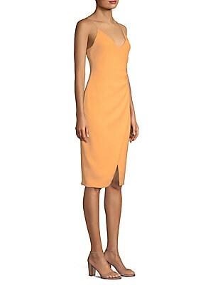 "Image of Alluring details elevate classic sheath dress V-neck Spaghetti straps Concealed back zip Side ruching Front slit Slim sheath silhouette About 44 from shoulder to hem Polyamide/elastane Dry clean Made in USA Model shown is 5'10"" (177cm) wearing US size 4."