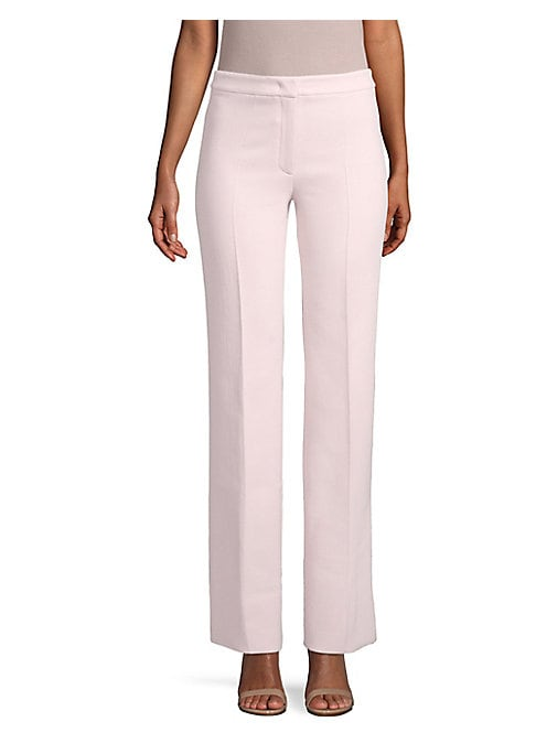 Image of Designed with a flared leg, these tailored pants are crafted from fine double crepe wool, making them a time-tested wardrobe essential. Banded waist. Zip fly. Back welt pockets. Rayon-cupro stretch lining. Wool. Dry clean. Made in Italy. SIZE & FIT. Model
