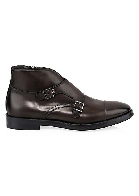 Image of Monk-strap ankle boots crafted from glossy leather. Rubber heel. Leather upper. Leather trim. Almond toe. Double adjustable monk strap. Leather lining and sole. Made in Italy.