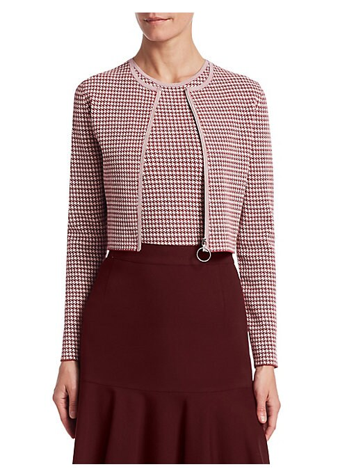 Image of Timeless houndstooth print adorns this tailored stretch jersey bolero jacket, perfect with sartorial skirts and trousers for a polished finish. Roundneck. Long sleeves. Front zip close. Viscose/polyester. Dry clean. Imported. SIZE & FIT. Cropped silhouett