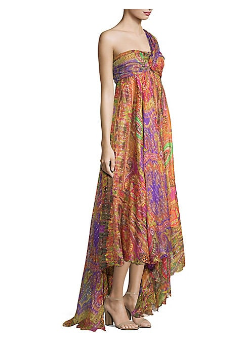 Image of EXCLUSIVELY AT SAKS FIFTH AVENUE. Pleats at the bust add a textural element to this diaphanous paisley-printed gown with metallic stripes throughout. The draped sharkbite hem encourages a footwear-focused look. One shoulder strap. Sleeveless. Sharkbite he