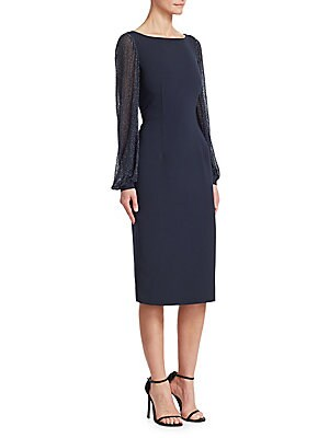 Image of Cut from lustrous silk, this femininely tailored gown features romantic blouson sleeves with metallic flecks throughout. Boatneck Long blouson sleeves Concealed back zip closure Lined Polyester/polyurethane Sleeves: Silk Dry clean Imported SIZE & FIT Abou