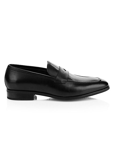Image of Leather penny loafers are a sleek footwear essential that lends dapper accents to any ensemble. Leather upper. Almond toe. Slip-on style. Leather lining. Rubber sole. Made in Italy.