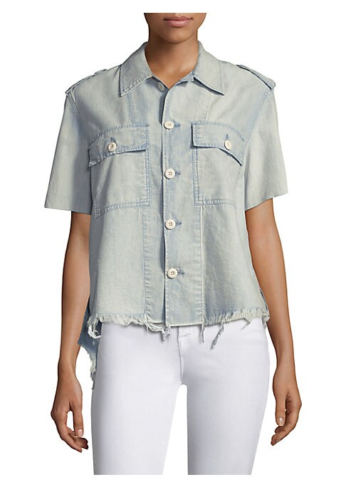 """Image of Cotton button-front shirt with distressed detailing. Fold-over collar. Short sleeves. Front flap button patch pockets. Button-front. Hi-lo hem. About 24"""" from shoulder to hem. Cotton. Machine wash. Made in USA. Model shown is 5'10"""" (177cm) wearing US size"""
