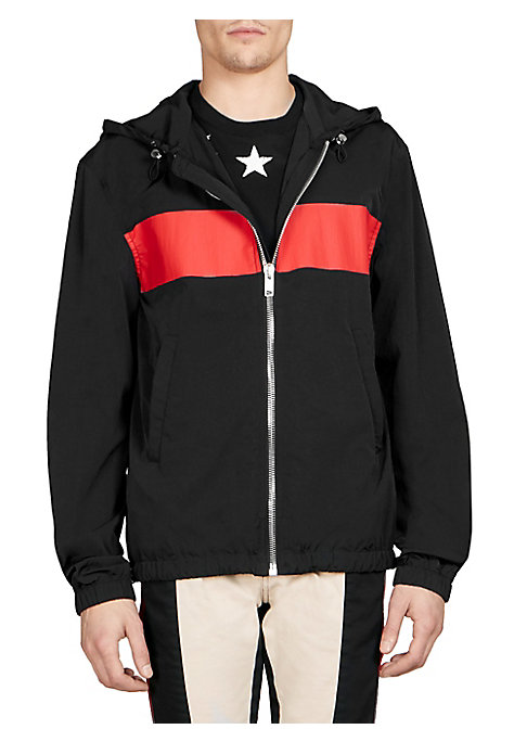 "Image of From the Saks IT LIST. GOOD SPORT. Performance pieces in innovative fabrications go beyond the gym. Sporty zip-front jacket with bold striped accent. Attached drawstring hood. Long sleeves. Front welt pockets. Zip-front. About 26"" from shoulder to hem. Po"