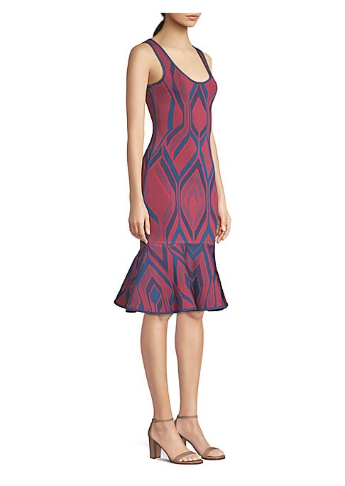 Image of Cut to flatter, this figure-hugging dress is crafted from the brand's signature stretch bandage fabric and falls to a dainty flutter hem. The bold geometric pattern adds a modern feel to a timeless silhouette. Scoopneck. Sleeveless. Concealed back zip. Fl