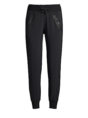Image of Stretch jogger pants with drawstring waist and elasticized cuffs. Elasticized drawstring waist Zip pockets at waist Viscose/acrylic Machine wash Imported SIZE & FIT Rise, about 7 Inseam, about 25 Model shown is 5'10 (177cm) wearing US size Small. Contempo