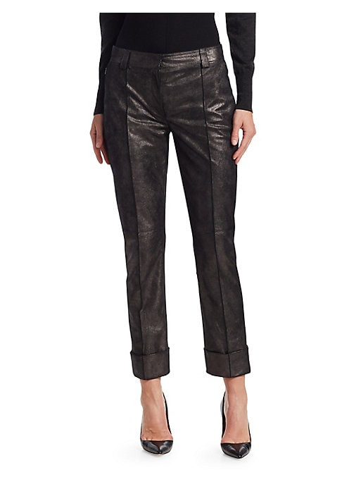 Image of The leather pant is a wardrobe staple for the rock star and the wannabe alike. This dressy iteration is crafted from a pearlized leather, with crisp frontal seams and generous cuffs making the pants feel very high-fashion. Belt loops. Zip fly closure. Sid