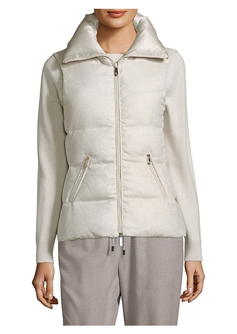 """Image of Quilted puffer vest in zip-front style. Stand collar. Sleeveless. Front zip pockets. Zip-front. About 23"""" from shoulder to hem. Polyester/viscose. Dry clean. Imported. .Model shown is 5'10"""" (177cm) wearing US size 4. ."""