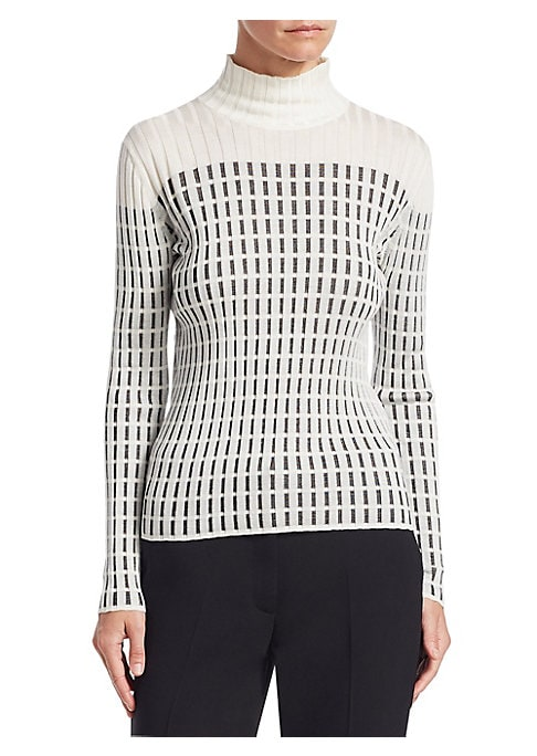 Image of Discreet luxury is the name of the game at Akris. This rib-knit sweater is one such example, crafted from pure silk and boasting a geometric two-tone pattern. Mockneck. Long sleeves. Pullover style. Silk. Dry clean. Imported of Italian fabric. SIZE & FIT.