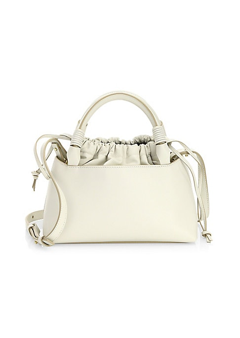 """Image of Chic mini handbag with crossbody strap featuring unique drawstring closure. Leather crossbody strap, 24"""".Double top handles. Drawstring closure. Interior slip pocket. Leather. Brasstone hardware.10""""W x 5""""H.Leather. Made in Italy."""