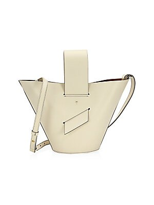 "Image of Crafted of smooth leather, this bucket bag features a removable crossbody strap Removable leather shoulder strap, 24"" drop Open top Goldtone hardware 13""W x 8""H Leather Made in Italy. Handbags - Collection Handbags > Saks Fifth Avenue. Carolina Santo Domi"