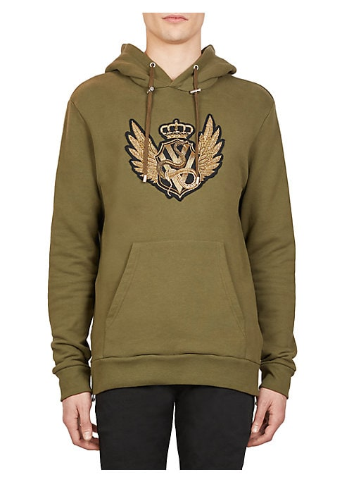 Image of A metallic embroidered crest and zip detailing enhance the classic hooded sweatshirt silhouette. Attached drawstring hood. Long sleeves. Ribbed cuffs and hems. Pullover style. Kangaroo pocket. Side split seams with zip detailing. Cotton. Machine wash. Mad