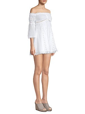 """Image of Off-the-shoulder lace dress with scalloped trim Off-the-shoulder Three-quarter sleeves Front tie detail Pullover style About 32"""" from shoulder to hem Cotton/polyester Hand wash Made in Spain Model shown is 5'10 (177cm) wearing US size Small. Contemporary"""