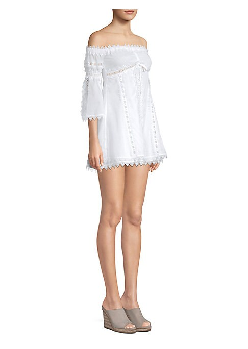 """Image of Off-the-shoulder lace dress with scalloped trim. Off-the-shoulder. Three-quarter sleeves. Front tie detail. Pullover style. About 32"""" from shoulder to hem. Cotton/polyester. Hand wash. Made in Spain. Model shown is 5'10"""" (177cm) wearing US size Small."""