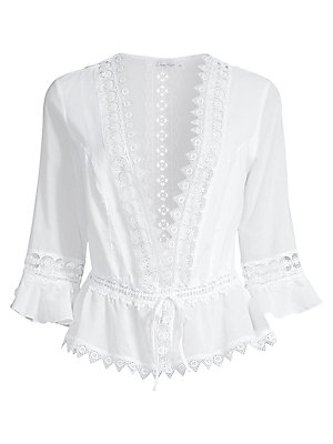 """Image of Romantic lace blouse with a daring plunge neckline and ruffled hem Deep V-neck Three-quarter sleeves Front tie closure About 17"""" from shoulder to hem Cotton/polyester Hand wash Made in Spain Model shown is 5'10 (177cm) wearing US size Small. Contemporary"""