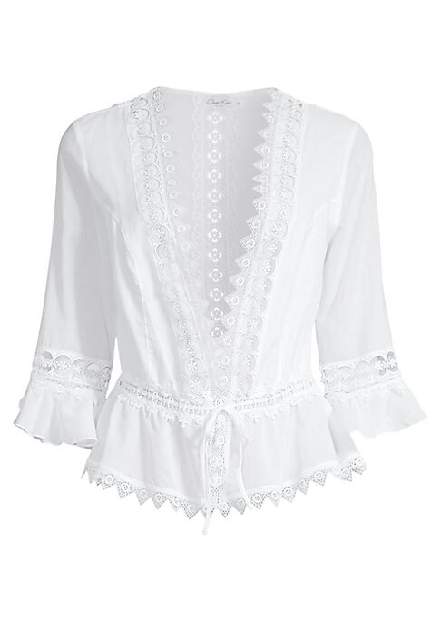 """Image of Romantic lace blouse with a daring plunge neckline and ruffled hem. Deep V-neck. Three-quarter sleeves. Front tie closure. About 17"""" from shoulder to hem. Cotton/polyester. Hand wash. Made in Spain. Model shown is 5'10"""" (177cm) wearing US size Small."""