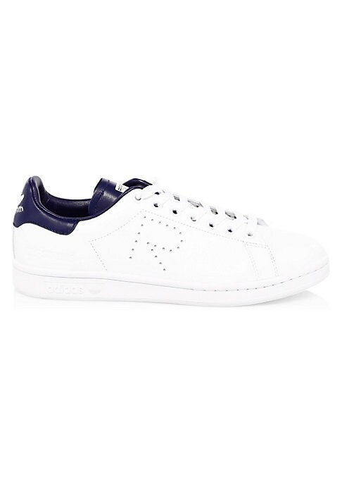 Image of Sporty leather sneakers with perforated detail. Leather upper. Round toe. Lace-up vamp. Rubber sole. Imported.