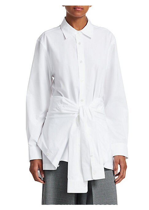Image of This reinvented button down reflects how the Alexander Wang brand keeps your looked polished without sacrificing playfulness or daring. The classic poplin construction is contrasted with a tie waist made of deconstructed sleeves and a hem tailored with a