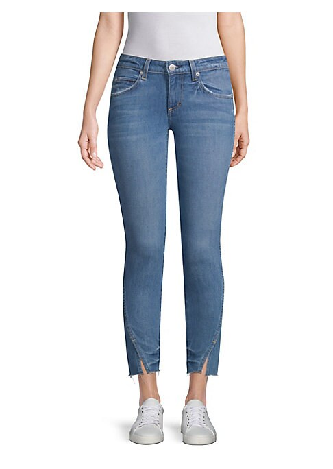 """Image of Asymmetrical seams refresh classic skinny jeans. Belt loops. Zip fly with button closure. Five-pocket style. Vented hem. Rise, about 8.5"""".Inseam, about 27"""".Leg opening, about 10"""".Cotton/elastane. Dry clean. Made in USA. Model shown is 5'10"""" (177cm) wearin"""