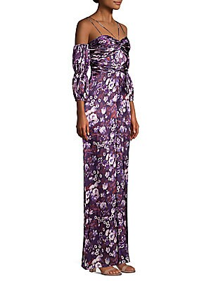 """Image of Abstract daisy print and ruched details elevate jumpsuit Sweetheart Double spaghetti straps Elbow-length cold-shoulder lantern sleeves Concealed back zip Cupro lining Inseam, about 30"""" About 64"""" from shoulder to hem Silk Dry clean Imported Model shown is"""