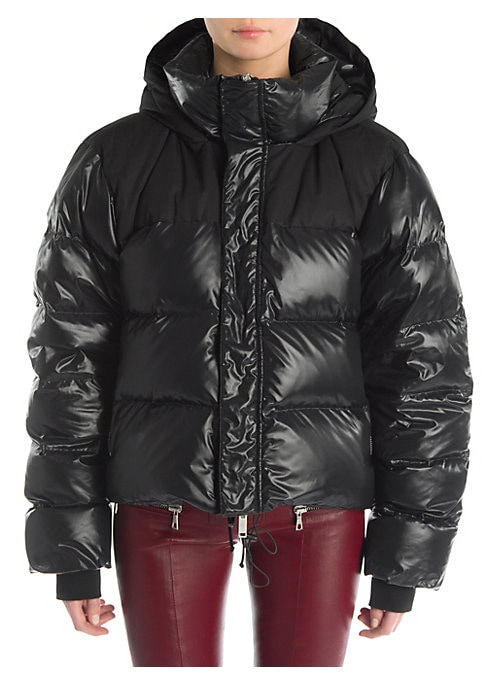 Image of A puffer jacket in a blown-up silhouette is a new wardrobe staple. Subtle details like embroidery and the juxtaposition of tone-on-tone fabrics elevate the garment. Stand collar with attached hood. Long sleeves. Ribbed cuffs. Concealed front zip and grip