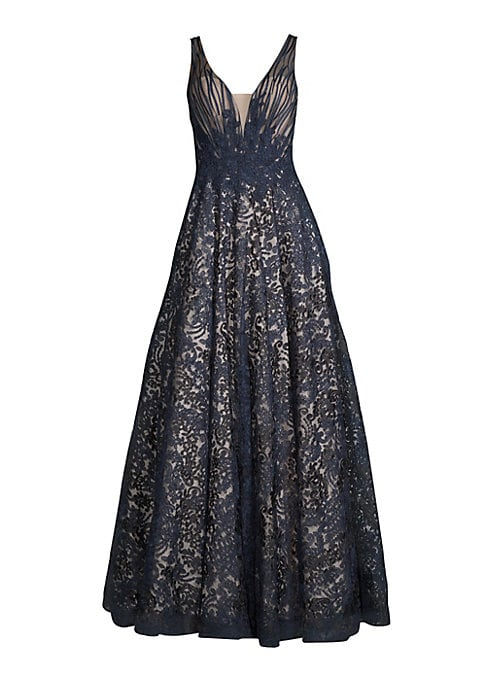 """Image of Beautiful fitted sleeveless ball gown with plunging v-neck and intricately embroidered patterns. Sleeveless. Concealed back zip closure. About 62"""" shoulder to hem. Polyester. Lined. Dry clean. Imported. Model shown is 5'10"""" (177cm) wearing US size 4."""