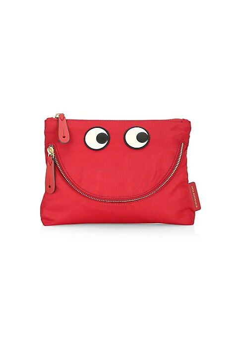 """Image of Eclectic pouch features embroidered eyes that are reminiscent of Anya Hindmarch's quirky spirit. Top zip closure. Goldtone hardware. One exterior front zip-around pocket. Nylon. Imported. SIZE.9.5""""W x 7""""H x 2""""D."""
