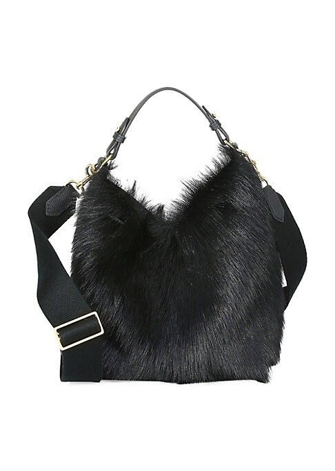 Image of Crafted out of plush shearling, this build a bag is the ideal canvas for accessories, straps and handles. Removable top handle. Removable, adjustable crossbody strap. Top tie closure. Outside zippered pocket. Goldtone hardware. Lining: Nylon/polyurethane.