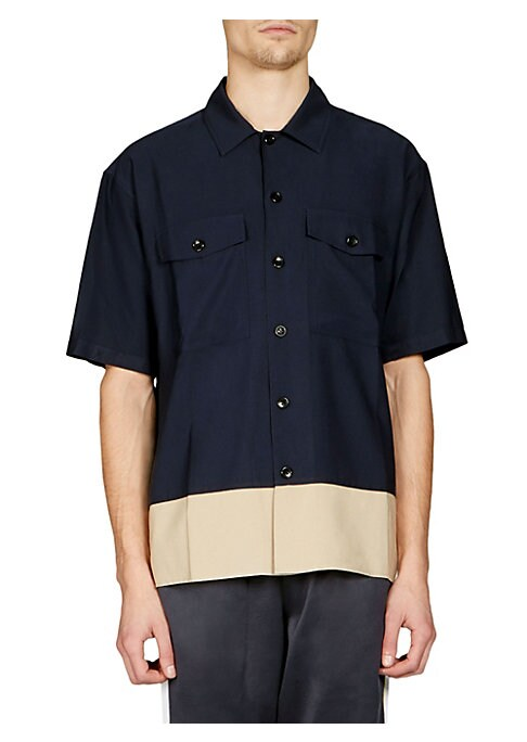 """Image of Button-front shirt with contrast color hem. Fold-over collar. Short sleeves. Front flap-button patch pockets. Button-front. About 26"""" from shoulder to hem. Polyester/viscose. Machine wash. Imported. ."""