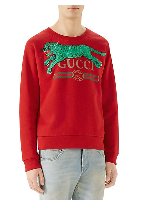"Image of Gucci logo sweatshirt with tiger. Washed felted cotton jersey. Gucci vintage logo. Embroidered tiger applique. About 26"" from shoulder to hem. Cotton. Machine wash. Made in Italy."