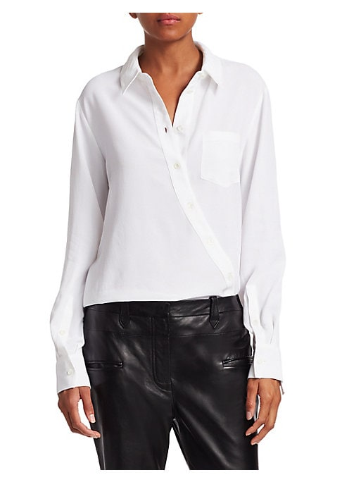 Image of Asymmetry offers edge to minimalist pieces. The diagonal button-front on this basic button-down shirt offers intricate styling to any ensemble. Spread collar. Long sleeves. Buttoned cuffs. Asymmetric button-front. Chest patch pocket. Shirttail hem. Matte